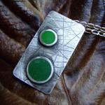 Silver pendant - Green coloured res..